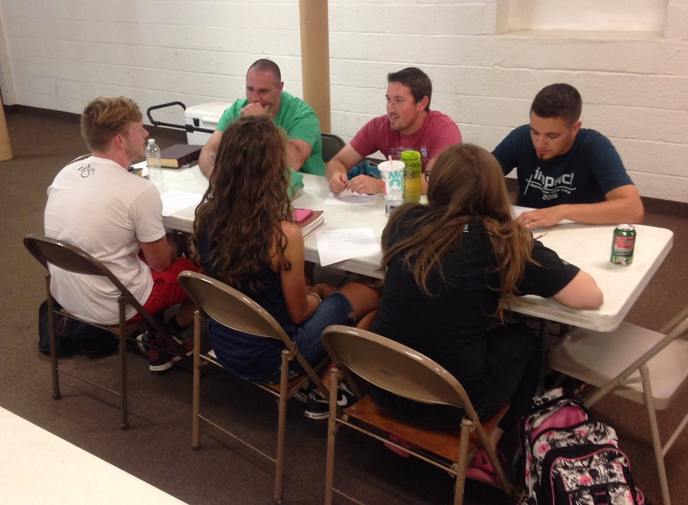 Members of the NBC team join with Spread The Word interns to take part in a daily POWER Group.