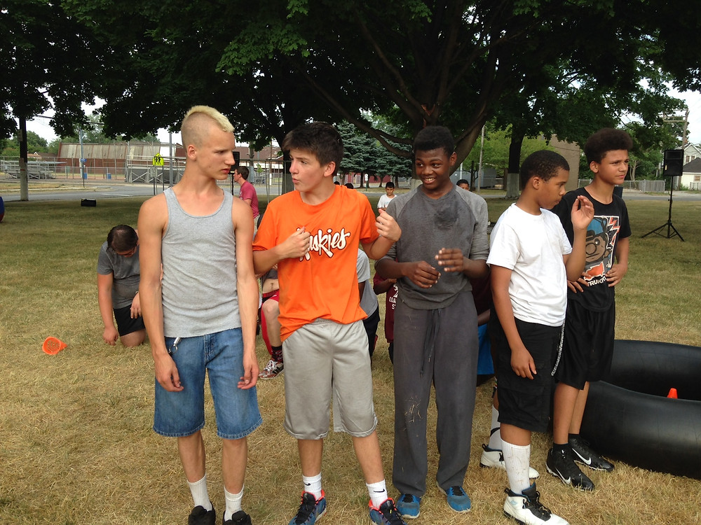 Dylan Zachary talks with his fellow Cola Wars teammates.