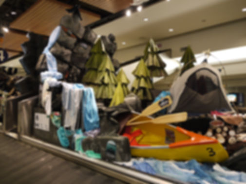 """Transformed"", Dimensional painted display made of luggage, promoting Alberta Parks and Parks Canada at Calgary airport"