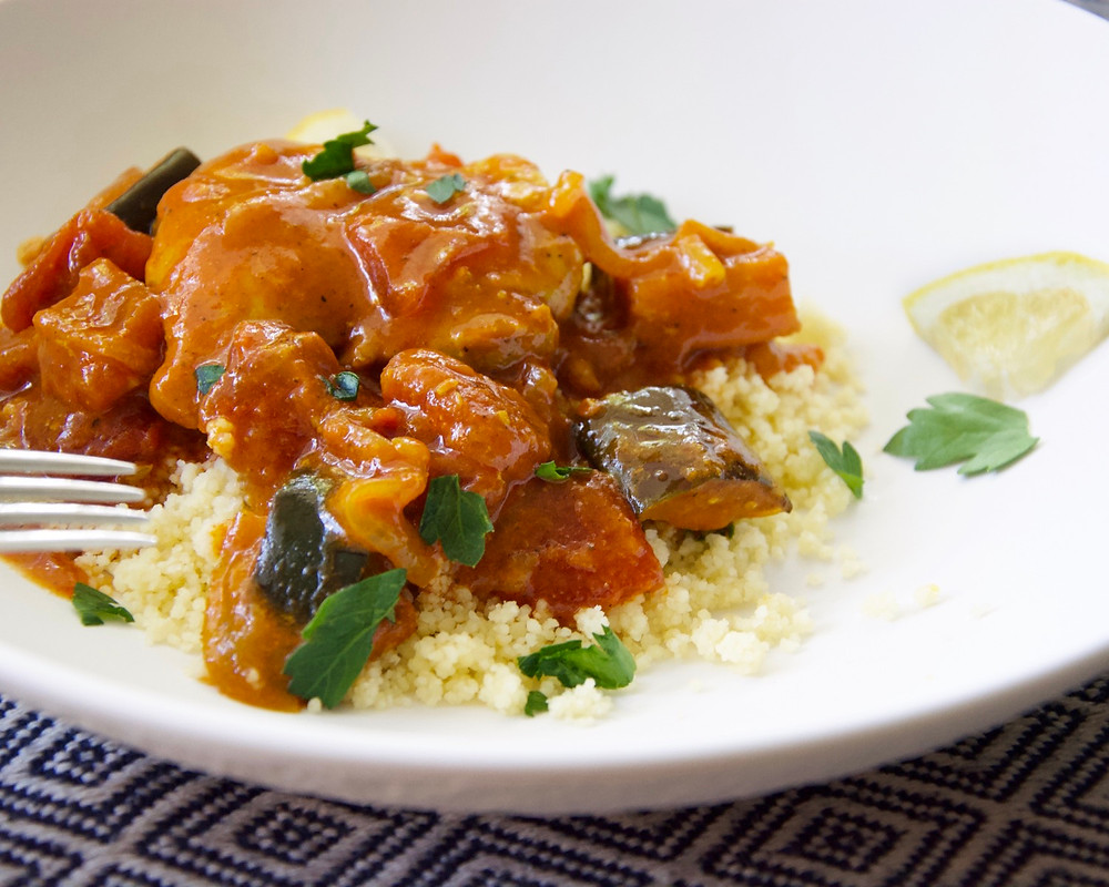 Side view of Moroccan Chicken with Eggplant over couscous