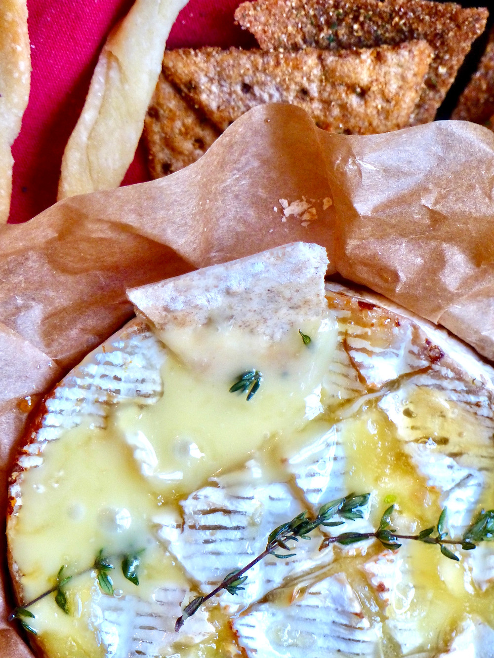 Baked camembert, stuffed with sliced garlic and drizzled with a truffle oil & honey mixture and thyme