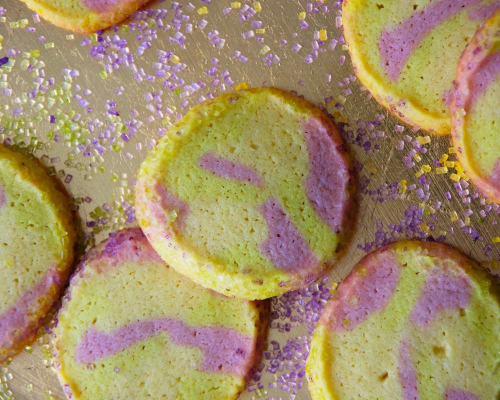 Tie-Dye Sugar Cookies in Mardi Gras colors, with sugar sprinkles.