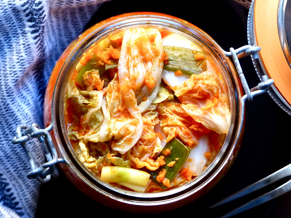 Homemade Kimchi made from fermented Napa cabbage and carrots with Korean flavors.