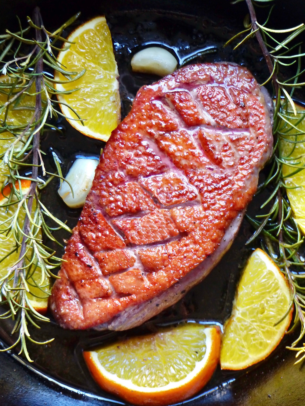 Pan seared duck breast with oranges, garlic and rosemary