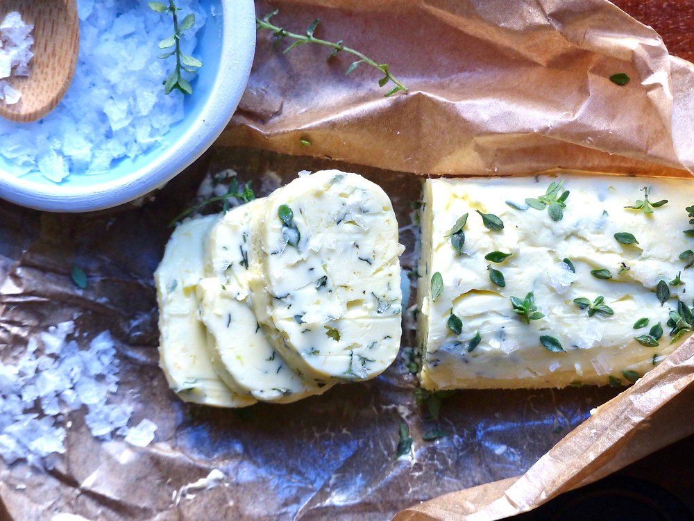 Compound butter with flaky sea salt, lemon zest and thyme leaves