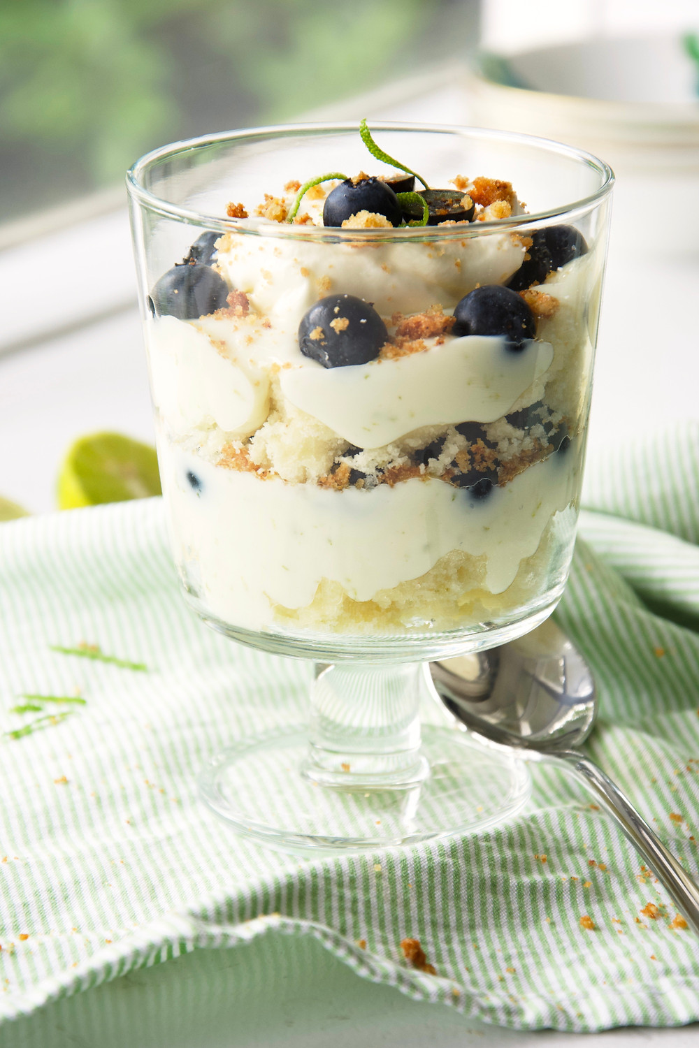Individual Key Lime Pie Trifles with layers of cake, key lime pie filling and blueberries.