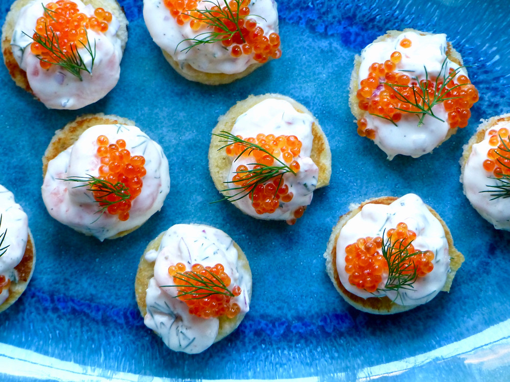 Prawns mixed with red onion, dill, crème fraîche and mayo on butter fried toast rounds topped with trout roe and an additional smattering of dill.