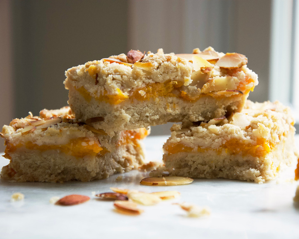 A small stack of apricot crumble bars.