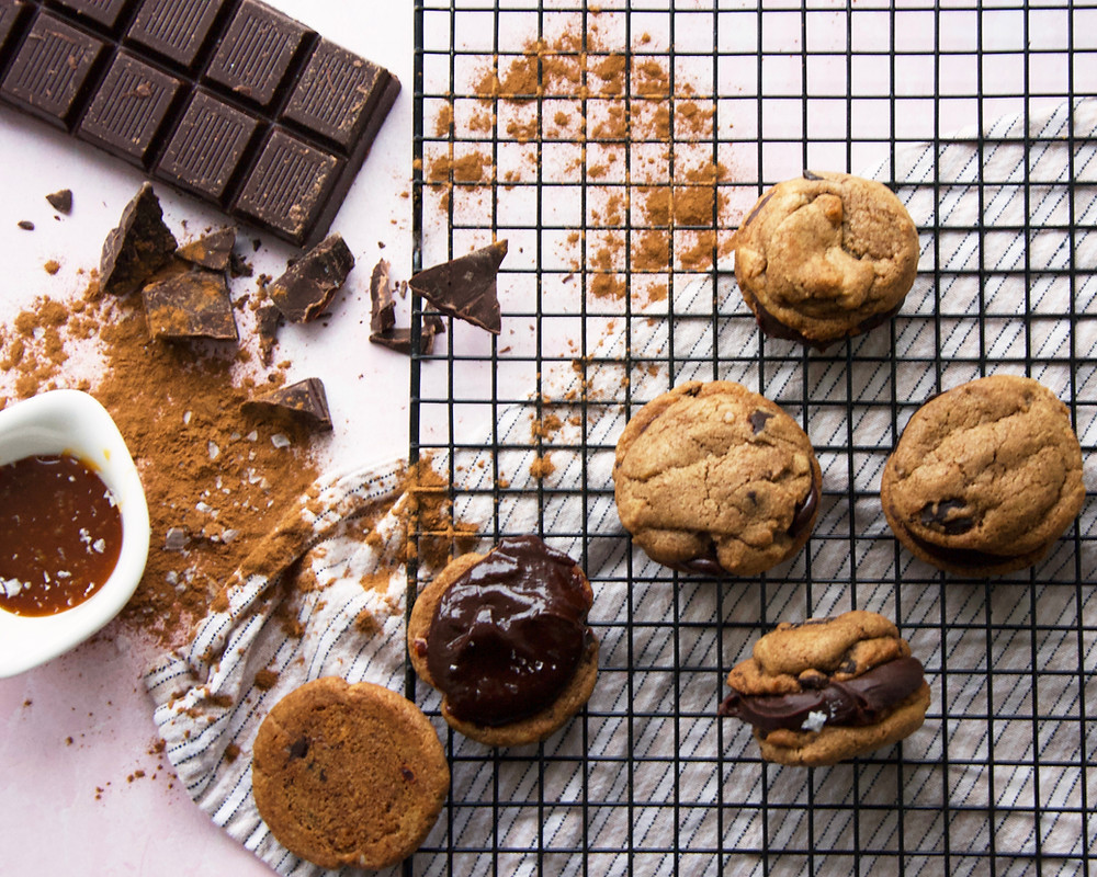 Coffee chocolate chip cookie sandwiches with salted caramel chocolate ganache.