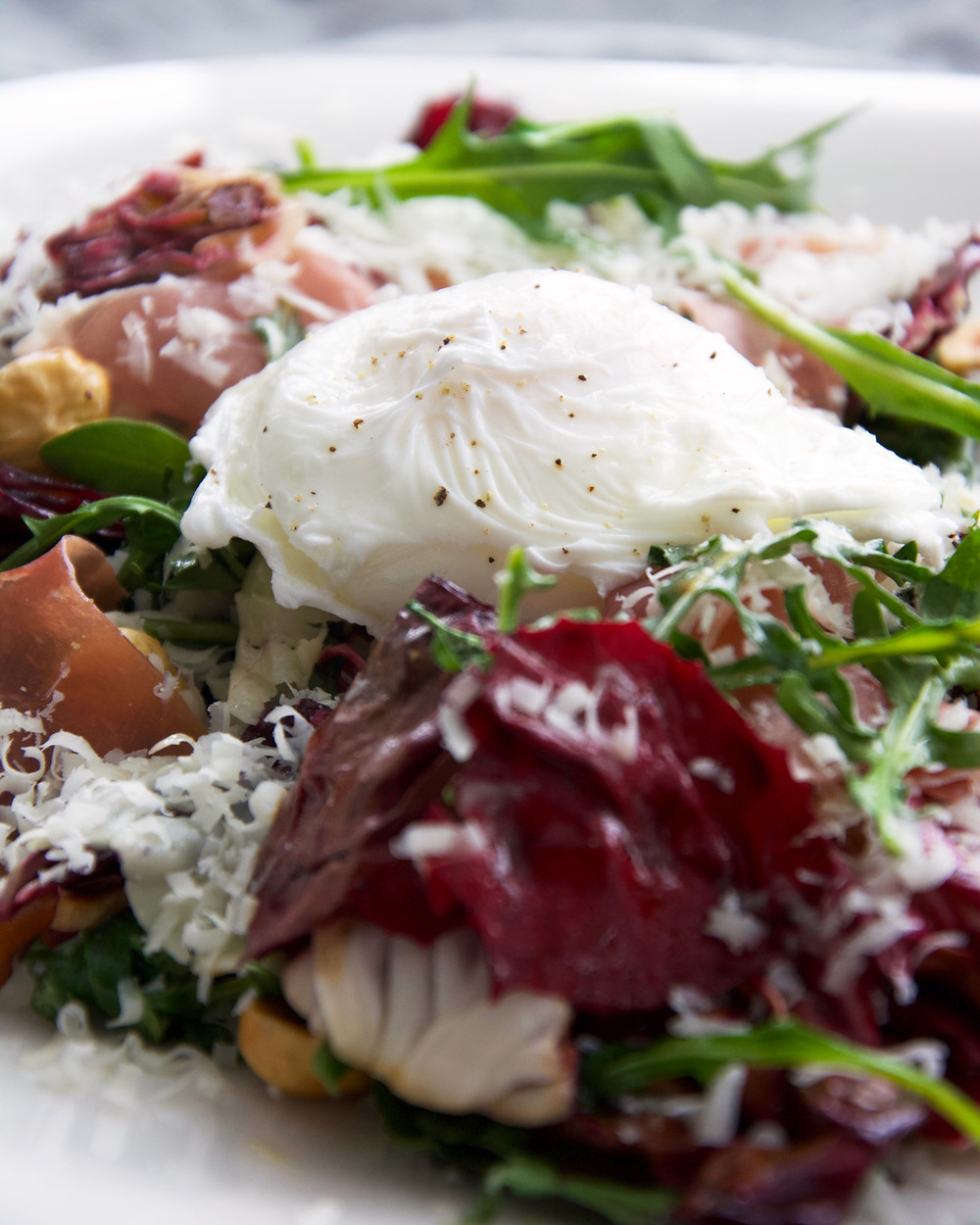 Grilled Radicchio Salad with hazelnuts, Pecorino Romano cheese, prosciutto and a softly poached egg