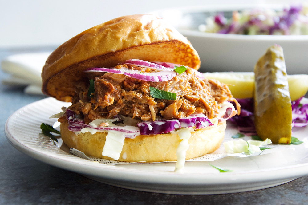 Pulled pork sandwich with slaw and red onion