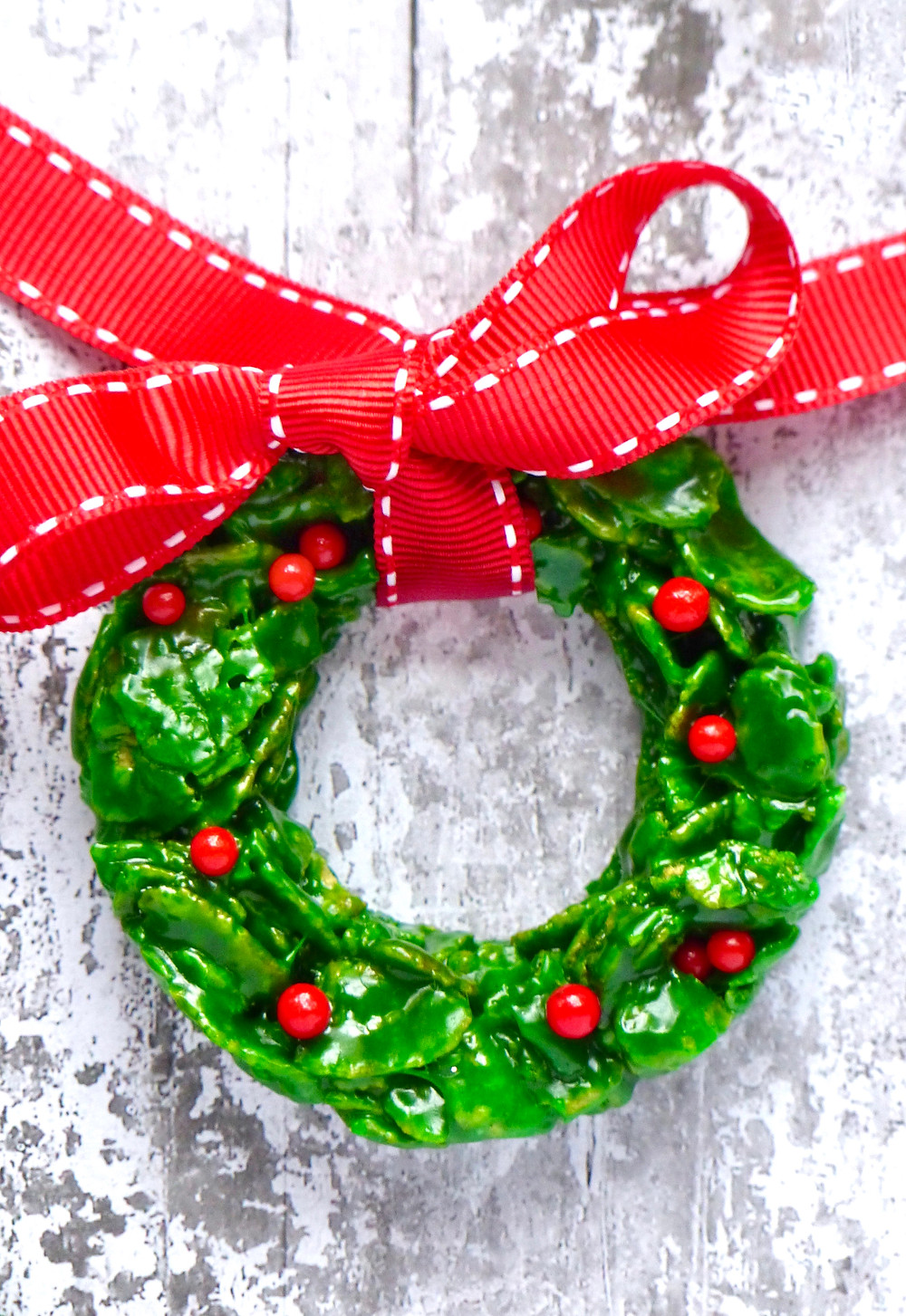 Green cornflake and marshmallow mini Christmas wreaths with red sugar balls
