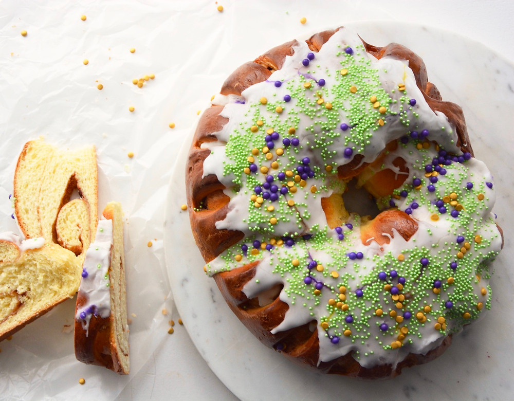 New Orleans style King Cake with icing and sprinkles