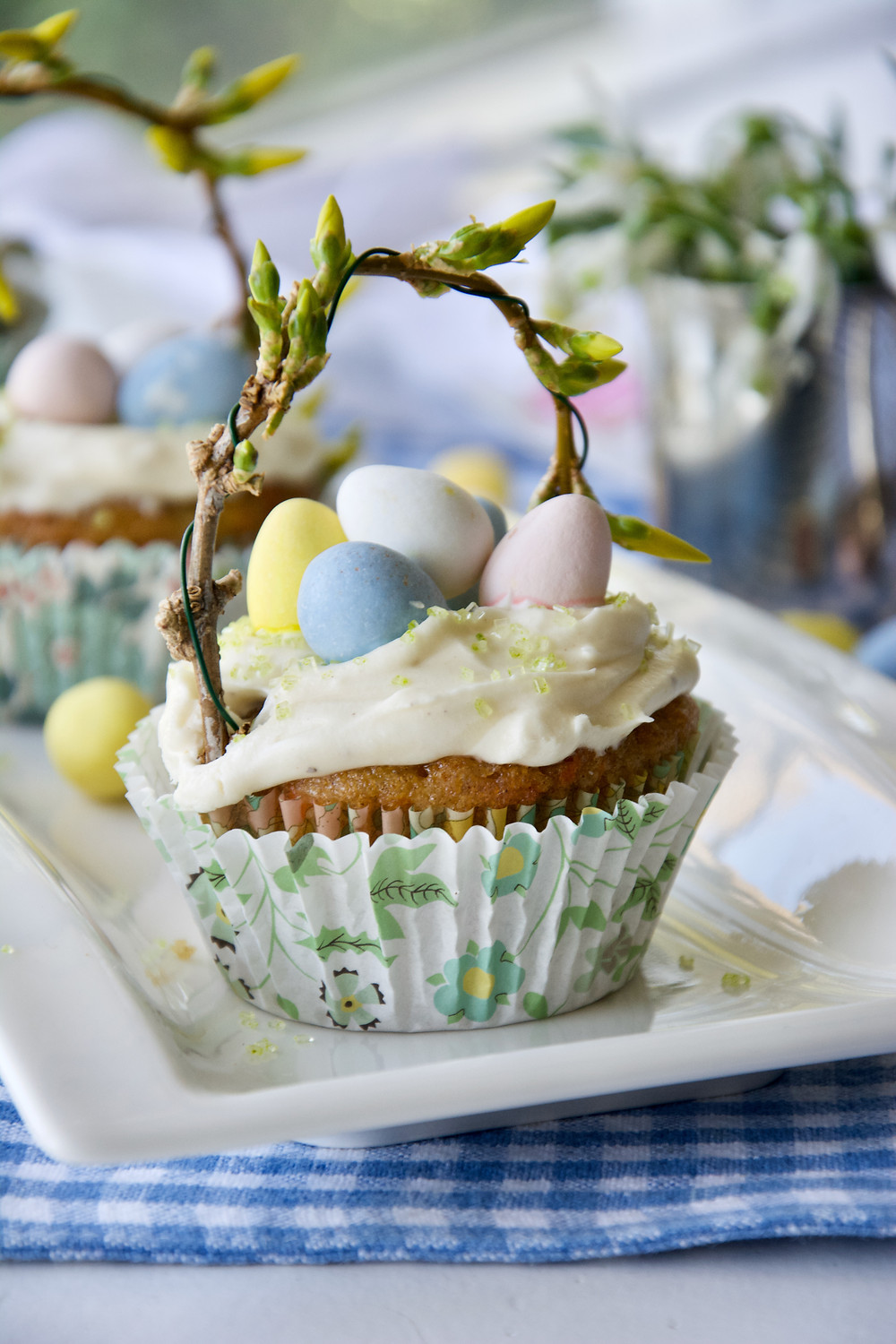 Carrot Cake Cupcake Basket with chocolate eggs and a floral handle.