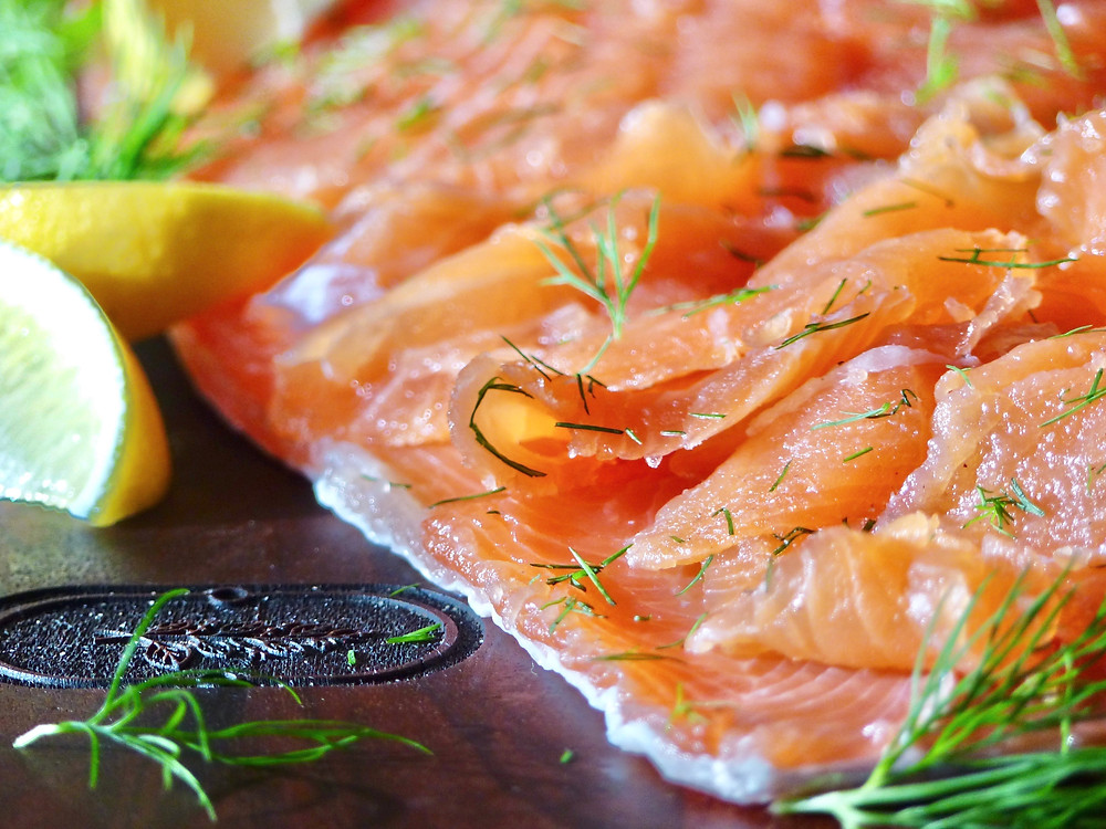 Cured Salmon, Gravlax, served with lemon wedges, dill and a mustard dill sauce