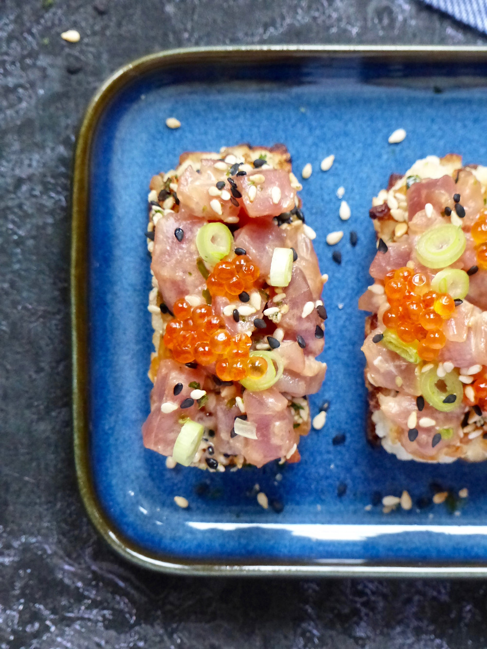 Crisp rice rectangles topped with a spicy tuna mixture with sriracha, sesame oil, soy sauce, scallions and trout roe