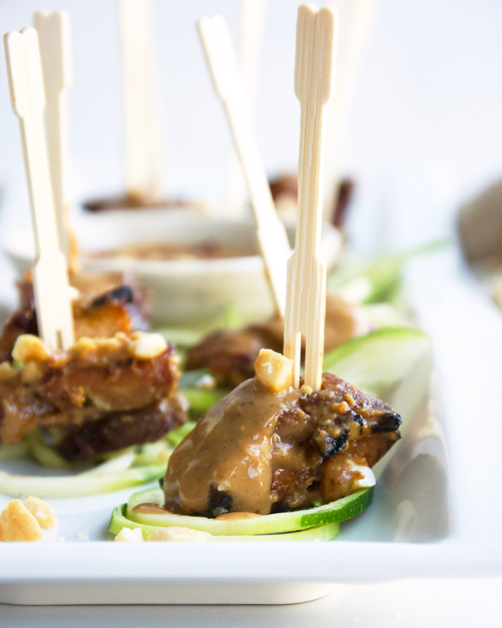 Chicken satay pieces on cocktail sticks. Served with peanut sauce.
