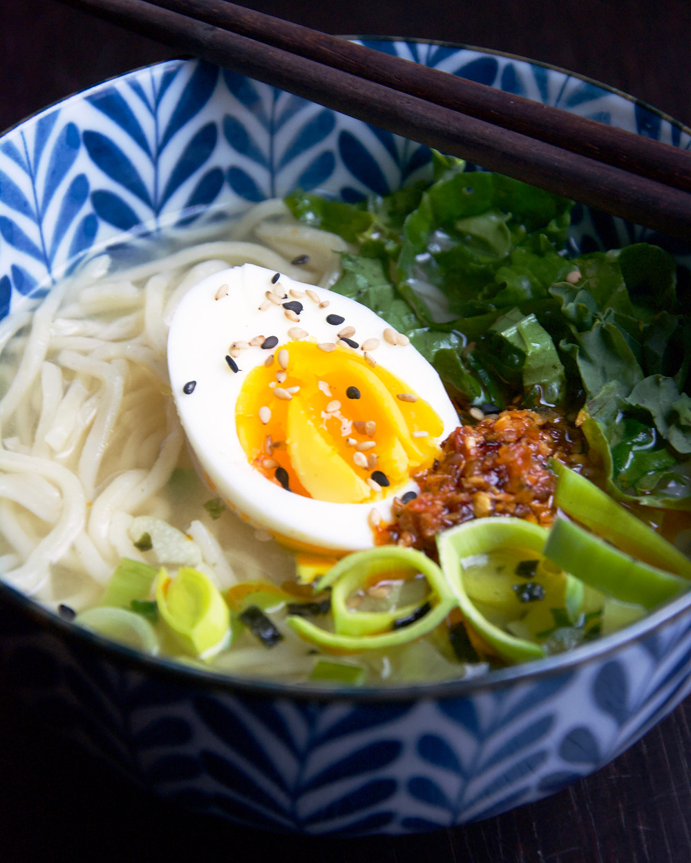 Close up of Miso Leek Soup with half an egg.