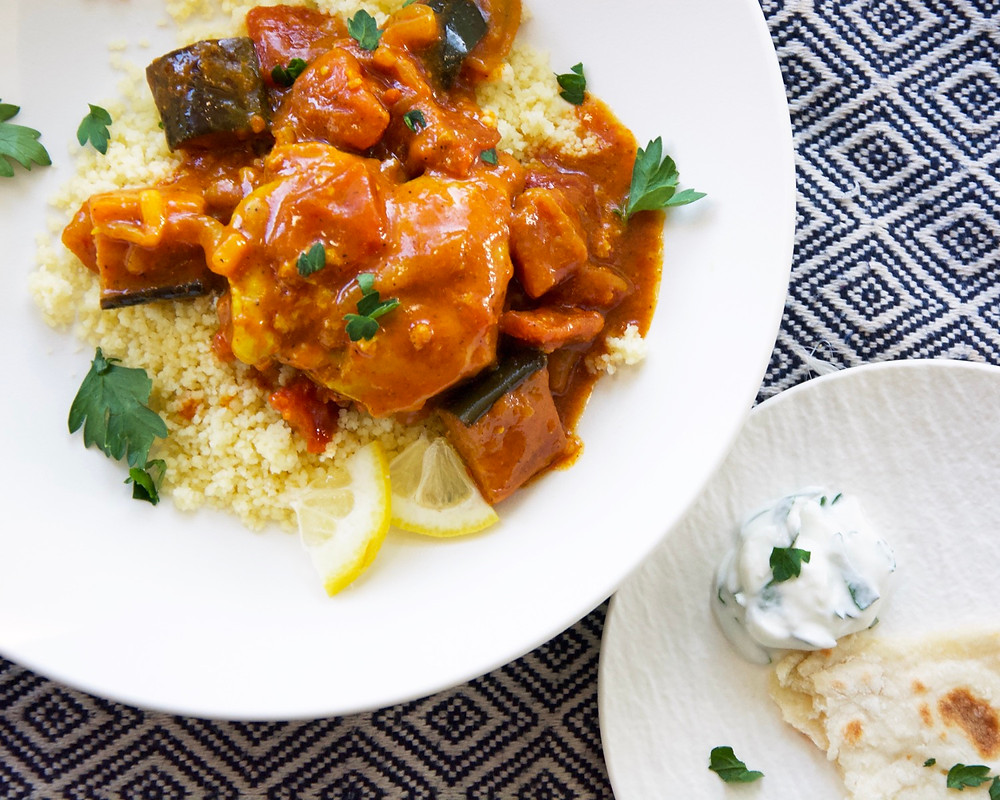 Moroccan Chicken with Eggplant over couscous with a side of naan bread