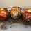 Thumbnail: Thick votive glass bowl bark design orange