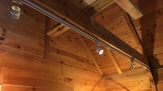Track lighting on exposed beam
