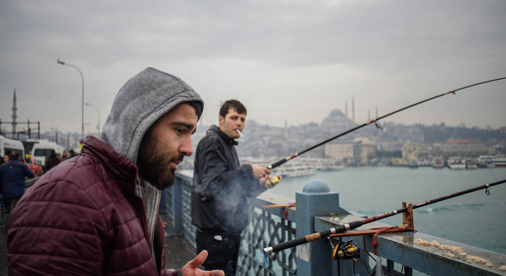 A fisherman taking a smoking break.