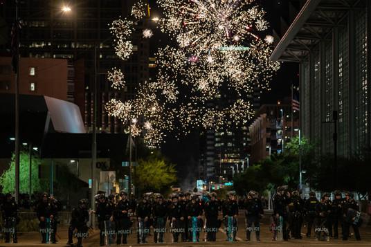 09. Fireworks by protestors seen behind