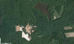 Photo aérienne du chantier de Guédelon et du Moulin Cognot