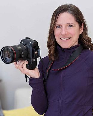 Christine McShane content creator holding camera