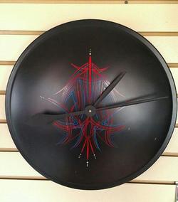 Moon Disk hub cap clock $100