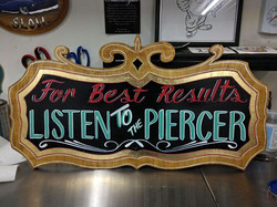 painted kustom sign for my very Good Friend and fanominal Body Piercer Angie Remmers.jpg