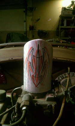 The new pinstriping on the stacks of my good friend todds 26 dodge rat rod