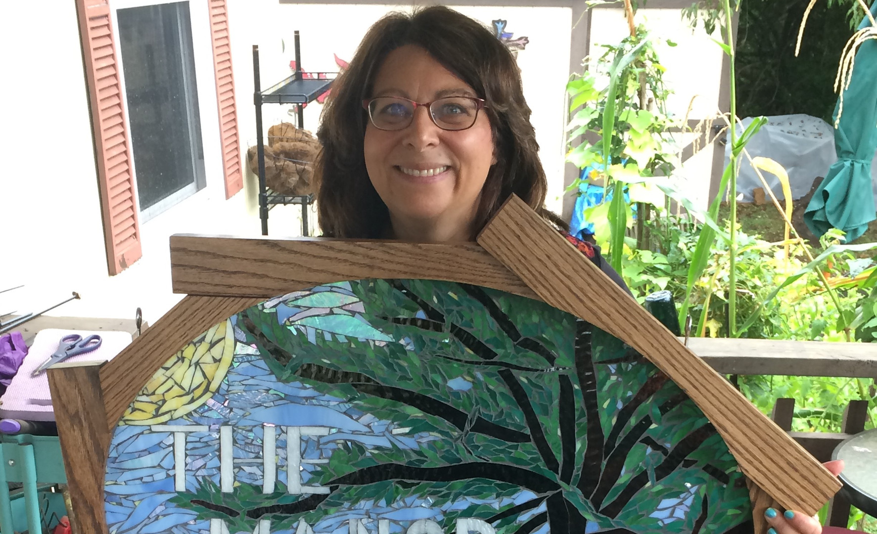 Debbie with finished stained glass mosaic