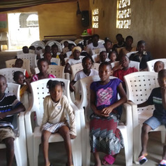 ...while the children sit attentively