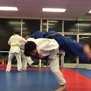 Josh throwing Alex.jpg