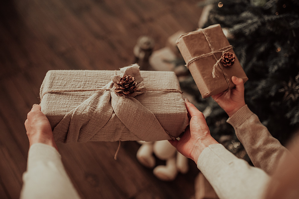 Christmas gift being given in eco friendly gift wrap