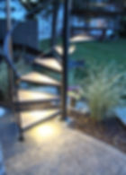 Spiral stair with lights outside to patio