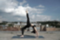 Girl Doing Yoga on a Rooftop
