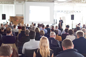 People attending a conference lecture