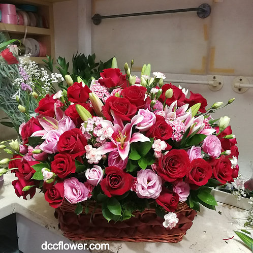 Red roses  & pink lilies basket