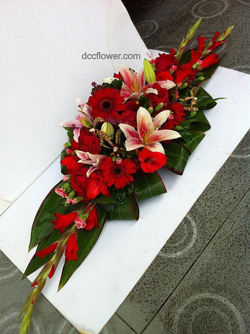Pink lily, rose, gerbera table arrangement