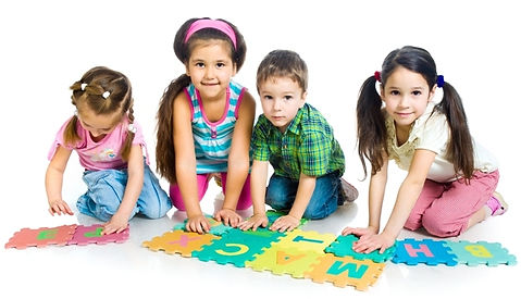 preschool aged children playing with letter tiles