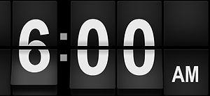 Digital clock showing 6:00AM