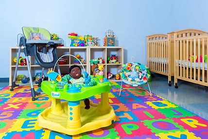 Odyssey Early Learning Academy's bright and inviting infant classroom, with colorful foam mats for safety.