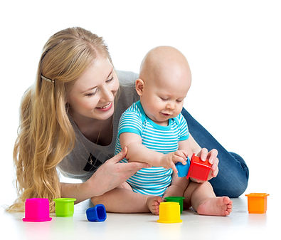 Teacher playing with a baby in the infant classroom