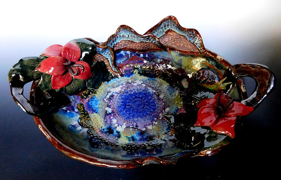 large oval bowl with flowers and snail
