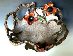 Nest bowl with poppies and lizard