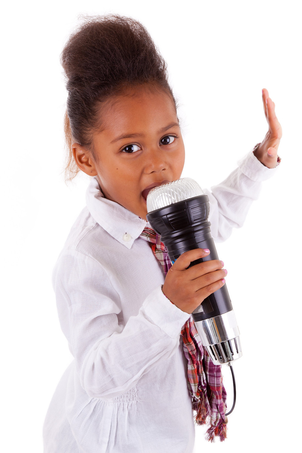 Photo of a young African-American girl singing demonstratively with a giant toy microphone.