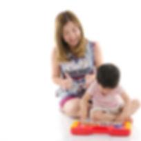 Asian Woman Child Piano dreamstimemedium_53953676.jpg