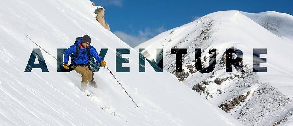 Skier on top of one of the peaks in summit